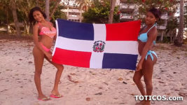Pair of hotties holding DR flag before Latina Threesome